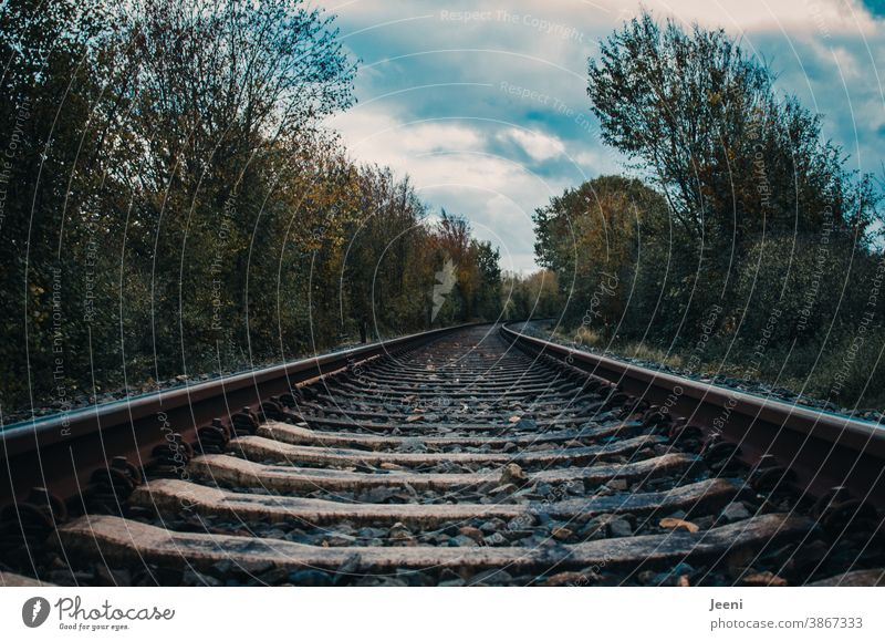 railway tracks in the landscape - blue sky and white clouds on the horizon Railroad tracks rails Speed travel Train Track Transport vacation Landscape Nature