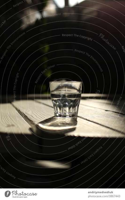 Clear water in a clear glass against. Healthy food and environmentally friendly natural water. a glass of water on a wooden table. drink health mineral green