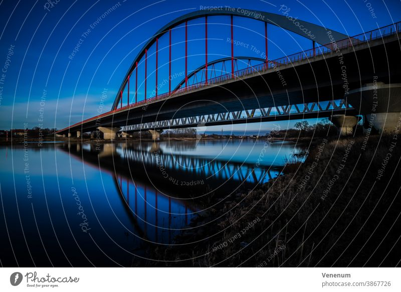 long time exposure , bridge over the Elbe in Lutherstadt-Wittenberg Steel iron bridge Arched bridge Overpass Street River Rivers Water Germany colored City