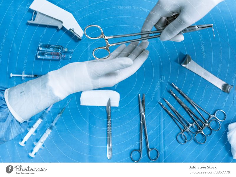 Surgeons using tools for surgery during operation surgeon instrument hand scissors operating theater medic assistant various hospital nurse together give pass