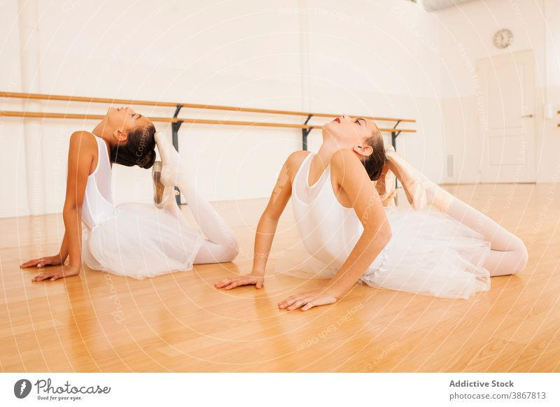 Flexible ballerinas stretching in dance studio body girl ballet together flexible hall pointe shoe teenage grace dancer charming perform classic lesson