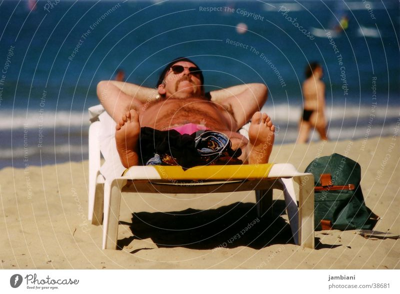 Man Vacation & Travel Ocean Beach Relaxation Coast Tourism Couch To enjoy Summer vacation Sunbathing Sunglasses Tourist Barefoot Single Deckchair