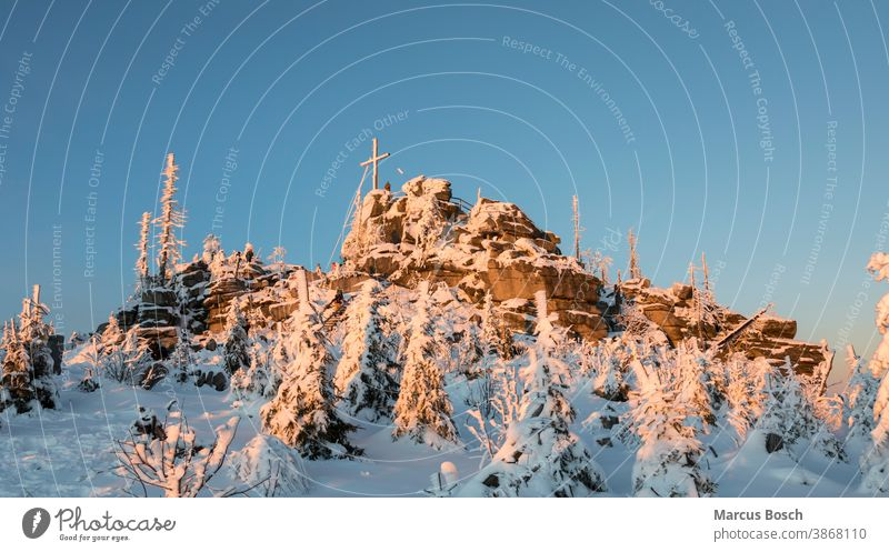 Three-seated rock in the evening light Triple chair Rock Frost granite rocks Highlands Evening sun evening mood Bavarian Forest Blue Ice Nature Snow snow