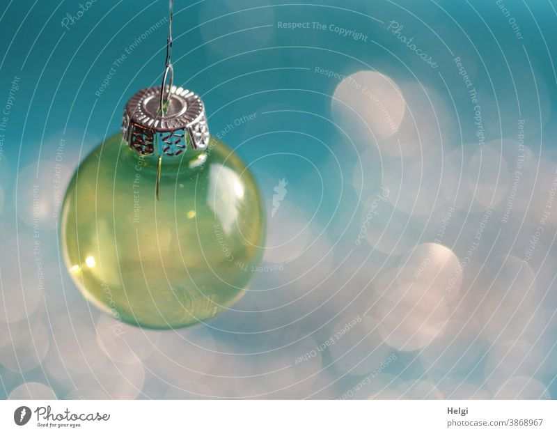 yellow glass christmas tree ball hangs in front of a turquoise background with Bokeh Sphere Glass ball Glitter Ball Christmas Christmas tree ball Decoration