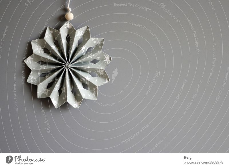 grey-white folded paper star in front of grey background Stars Rosette Decoration Christmas Advent christmas ornaments Christmas decoration Paper Folded Gray