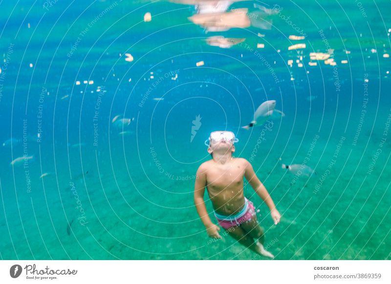 Little kid diving on the Mediterranean sea active adventure camp animals aqua baby bahamas banner beach vacation caribbean tour cheerful child childhood