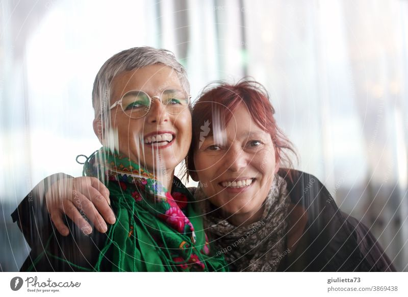 Portrait of two beautiful, laughing women, friends, 50 plus, happy girlfriends Friendship Happiness Together Woman Happy Adults Laughter Exterior shot
