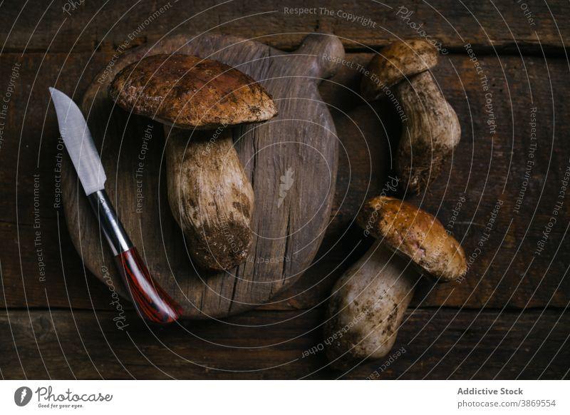 Porcini mushrooms and knife on table porcini boletus edulis cep cut fresh raw edible fungus organic food natural nutrition rustic ingredient vegan penny bun