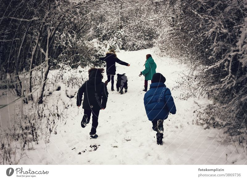 jumping children on a snowy path Winter vacation snowed over be a child Playing Infancy Snowscape preschool child childcare Winter sports Parenting