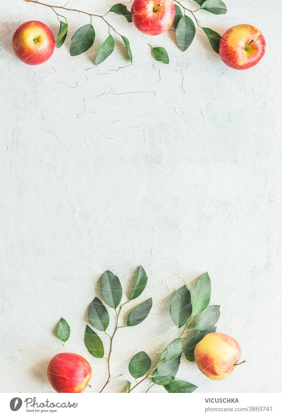 Frame made with apples with green leaves on white background. Top view frame apple tree twigs pattern top view sweet flat table layout freshness ripe group raw