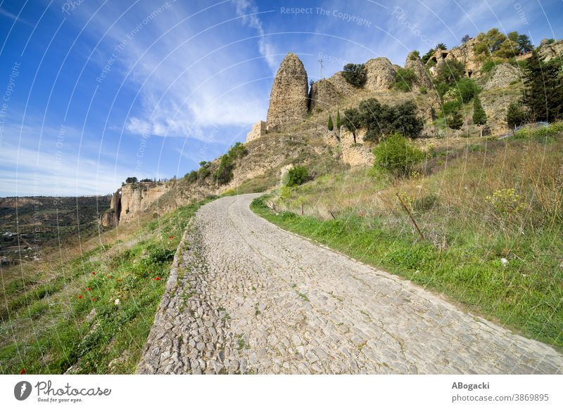 Cobbled Rural Road in Andalusia Countryside, Spain andalucia andalusia landscape spain rock ronda mountain steep slope country countryside rural nature outdoor