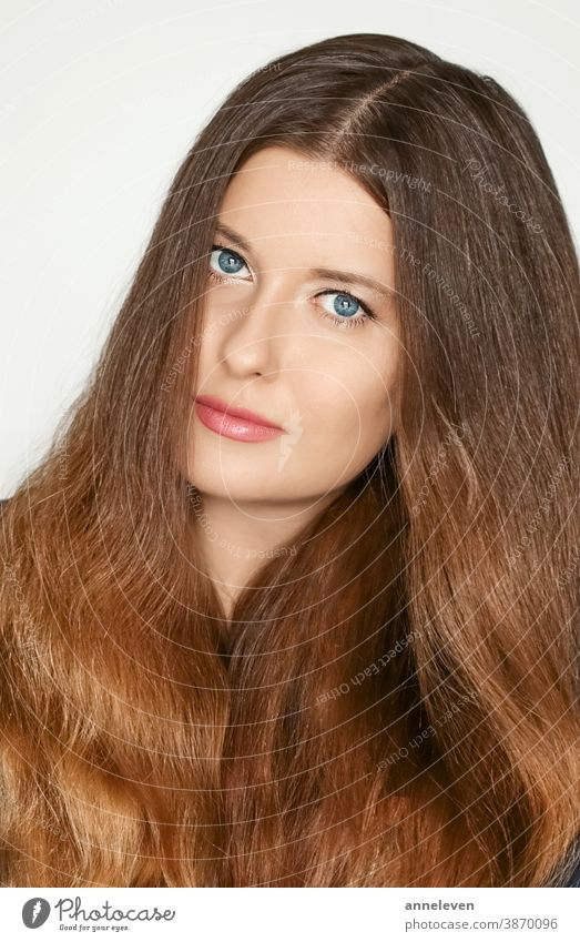 Haircare and beauty portrait, beautiful model woman with long brown healthy hair, natural hairstyle 30s brand brunette campaign caucasian clip clips color