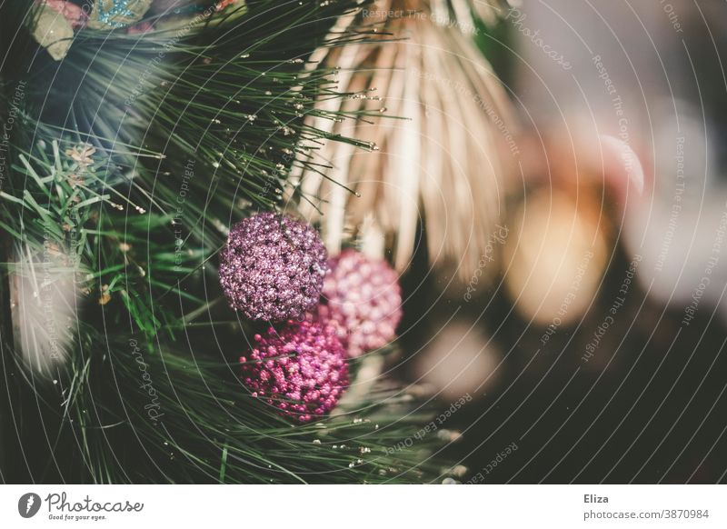 Glittering golden and pastel-coloured Christmas decoration baubles fir branches glittering pastel shades pink purple pretty Christmas & Advent