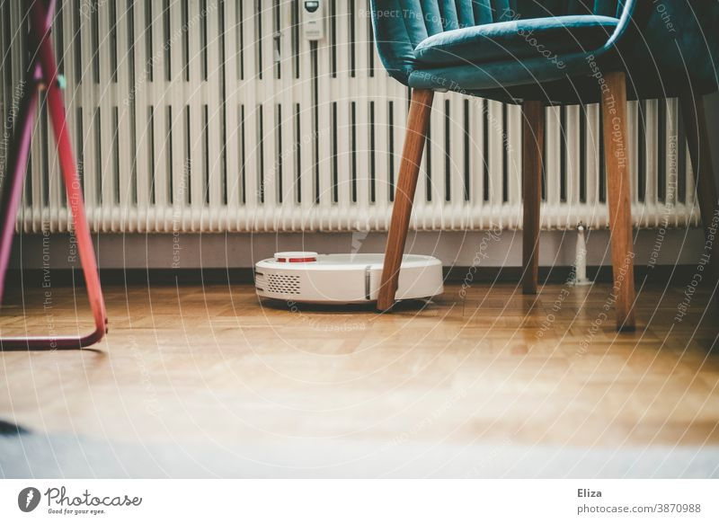 A robot vacuum cleaner cleans the apartment diligently and independently and makes household chores easier Vacuum cleaner robot Robot Household Vacuuming