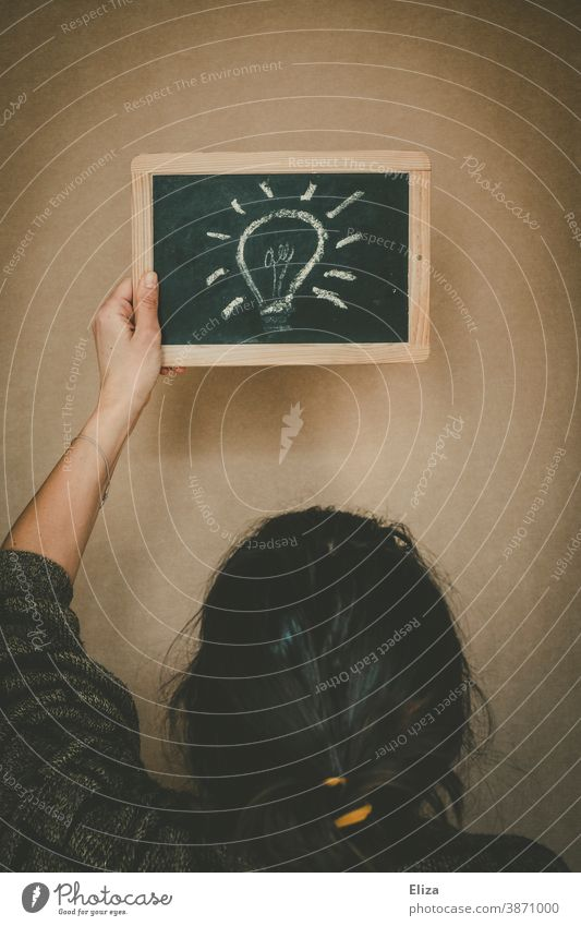 A light bulb painted on a blackboard. Concept a woman has an idea. Idea Creativity Electric bulb solution Inspiration concept have an idea Think innovation