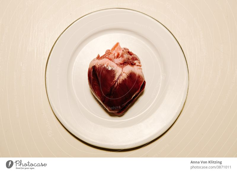 heart Heart innards Organ Red heart-shaped Animal Plate White Contrast long Raw Meat Butcher Hunter Blood Cardiovascular system Beat
