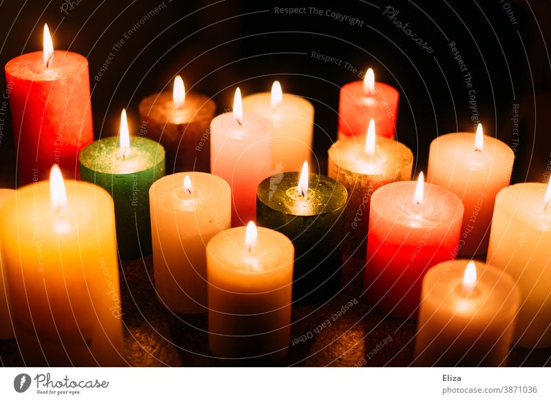 Many colourful burning candles Candlelight variegated cauterizing blaze Candlelit ambience Various