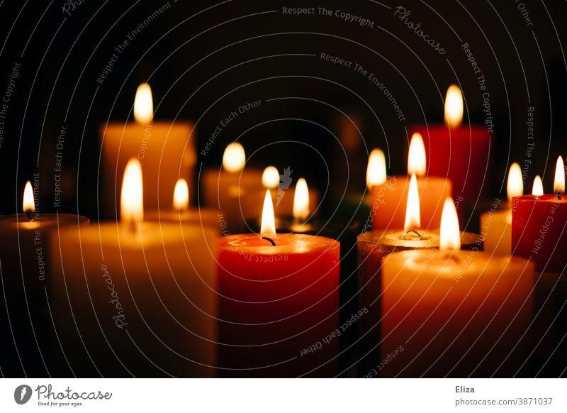 Many colourful burning candles Candlelight variegated cauterizing blaze Candlelit ambience Various Cozy atmospheric
