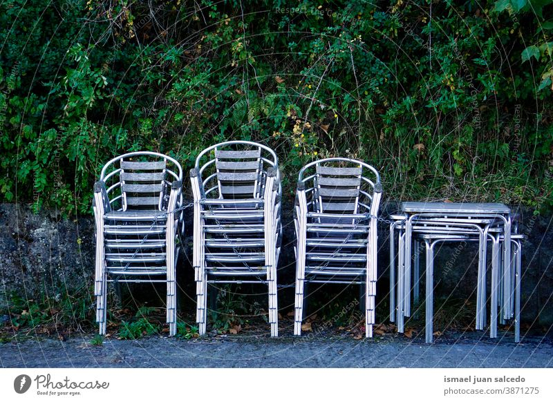 metallic chairs on the street streetphotography Seating seat Empty Row of chairs Seating capacity Places Sit Colour photo Furniture tables