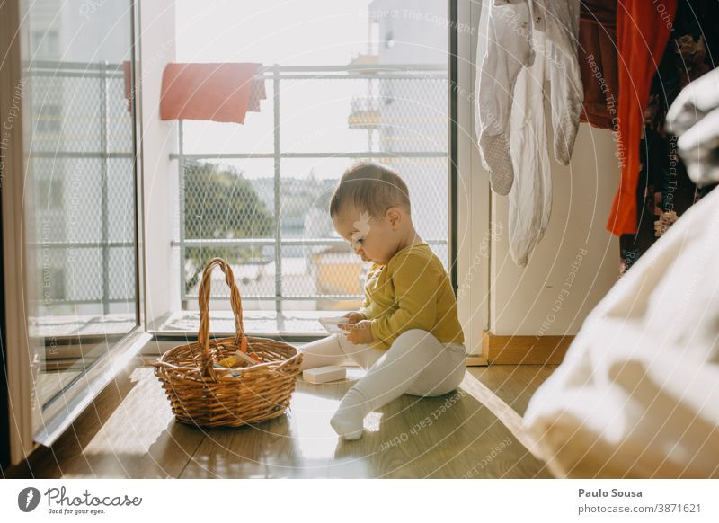 Toddler playing at Home Child childhood 0 - 12 months Colour photo Baby Infancy Cute Small Family & Relations Interior shot Human being Day Caucasian Happiness