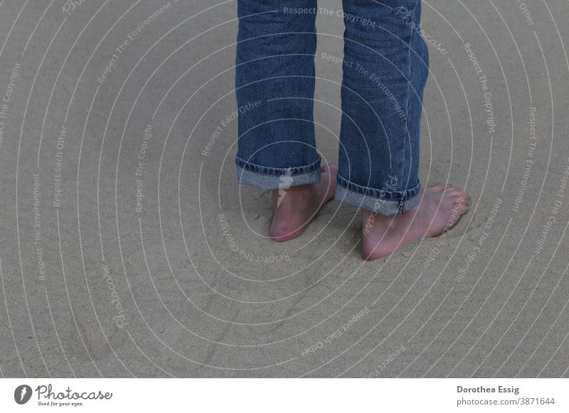 Barefoot in the sand feet naked feet Men's Feet Sand Beach Close-up colored jeans Day Exterior shot Ocean Stand Colour photo
