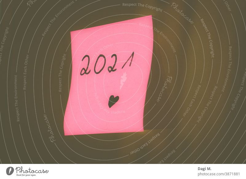 Year 2021 on pink Post-It, New Year, New Year's Eve, New Year turn of the year new year Cheers Future