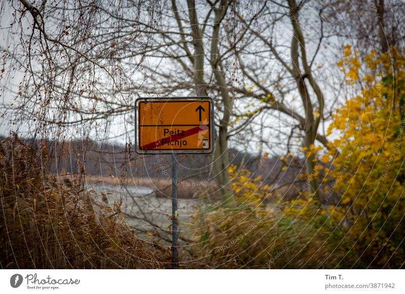 town exit sign Peitz in autumn Lausitz forest Autumn Brandenburg Signs and labeling Town sign Deserted Exterior shot Colour photo Day Street