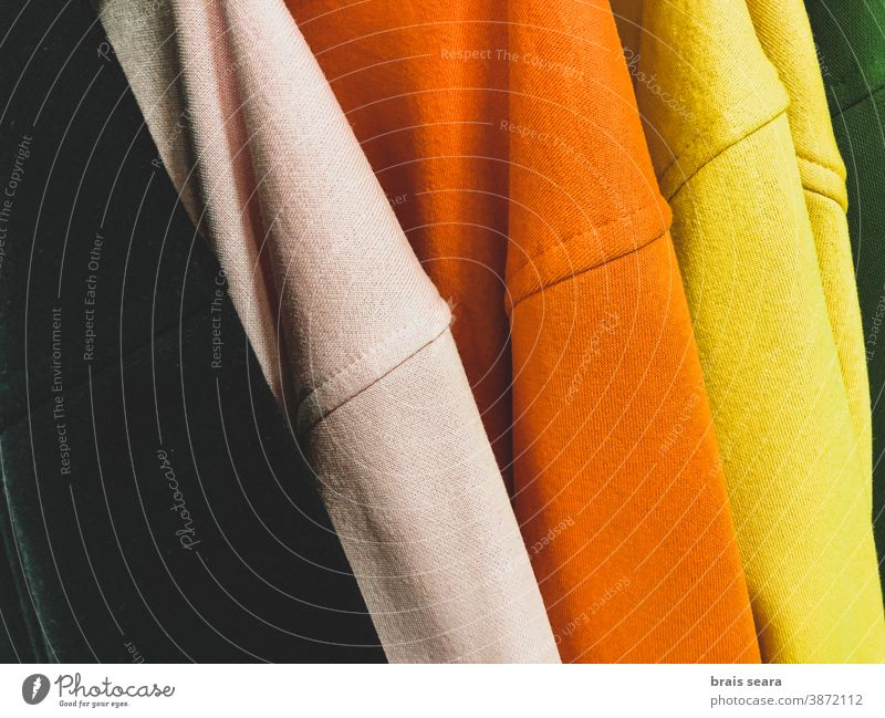 Multi colored sweatshirts on the coat rack fashion colours clothes clean laundry multicolor background colors shopping center home elegance ripple cotton