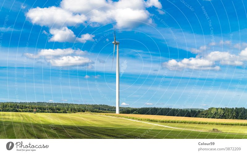 Wind turbine surrounded by agricultural land energy windmill renewable detail generator alternative electricity technology blade farm environmental