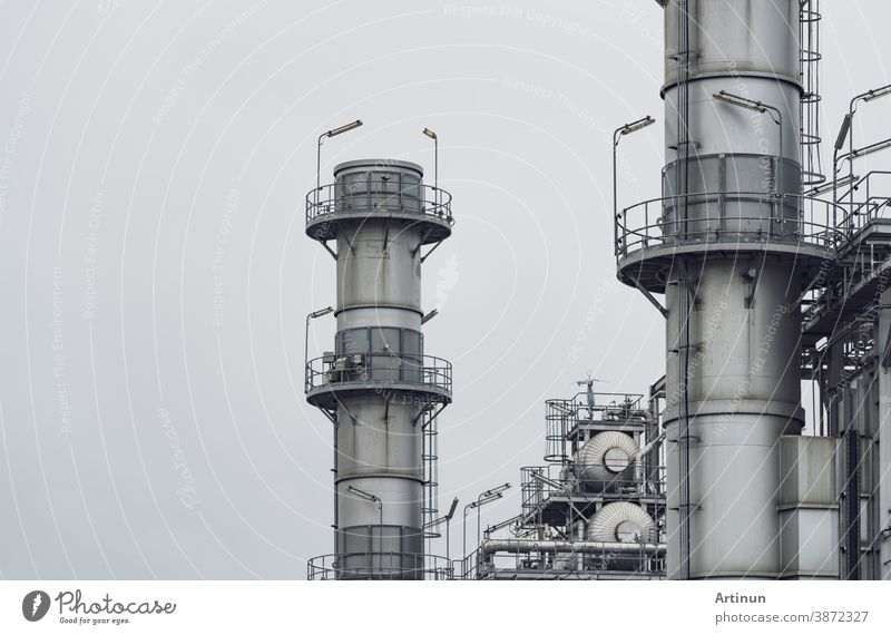 Gas turbine electrical power plant. Energy for support factory. Natural gas tank. Chimney tower of gas power plant. Power plant using natural gas for fuel. Green energy. Power station against gray sky