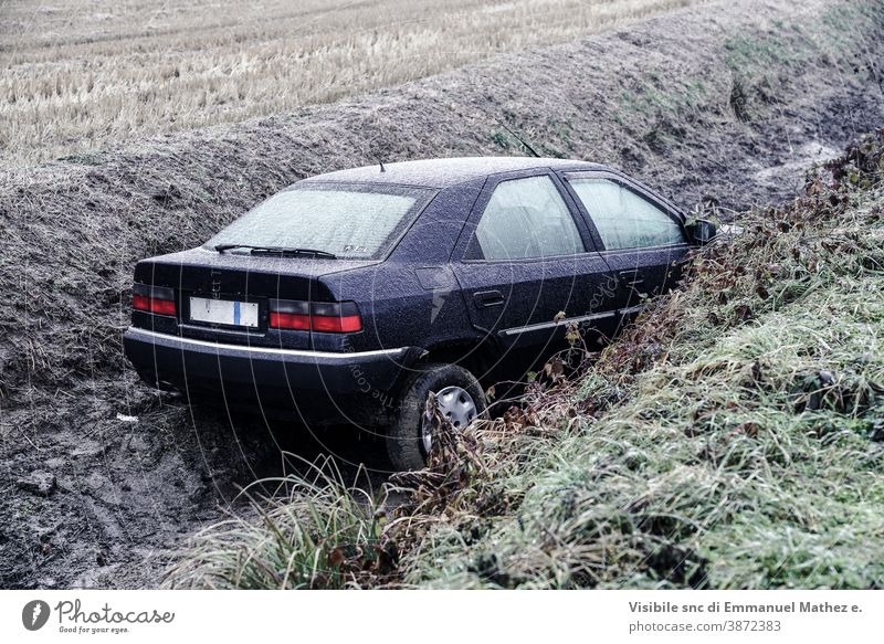 car ended up in a ditch due to ice in Lombardy, north Italy damaged accident crash drift wreck winter broken vehicle behaviour destroyed circulation route