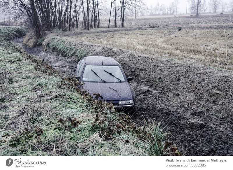 car ended up in a ditch due to ice in north Italy damaged accident crash drift wreck winter broken vehicle behaviour destroyed circulation route surprise