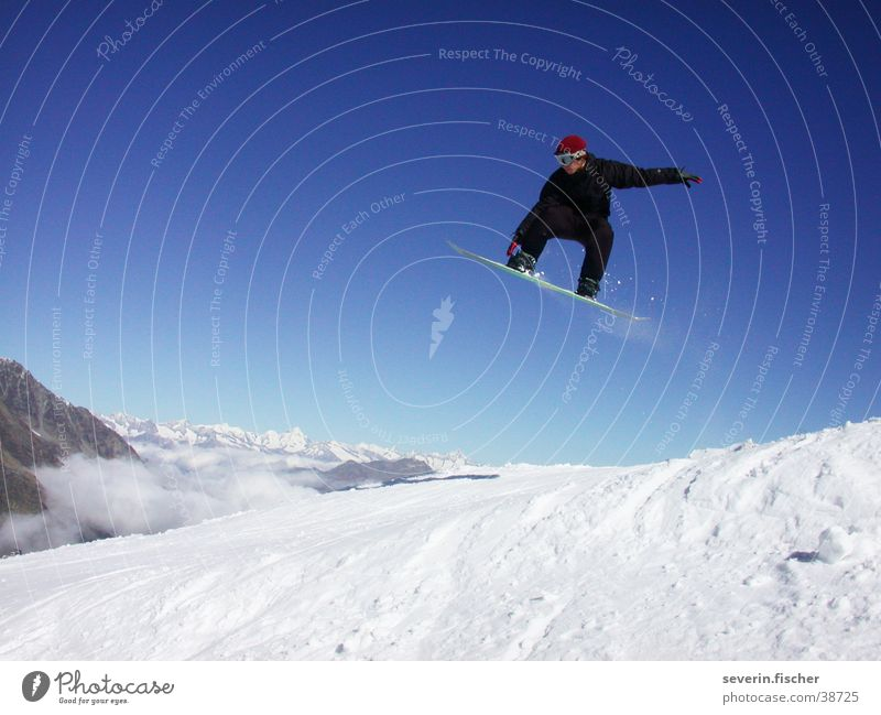 jibber Switzerland Winter Canton Wallis Snowboarding Straight jump Jump Sports Saas Fee grap Mountain Air Snowboarder Trick jump