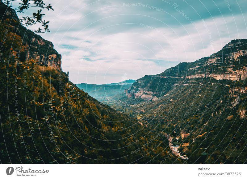 Landscape with views of green fields and majestic mountains Cingles de Bertí Riscos de Berti sant miquel del fai landscape trees grove nature vegetation natural