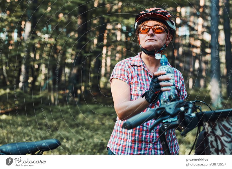 Active woman spending vacation summer time on a bicycle trip in a forest joy freedom fall recreation adventure enjoy forest landscape forest trees forest path