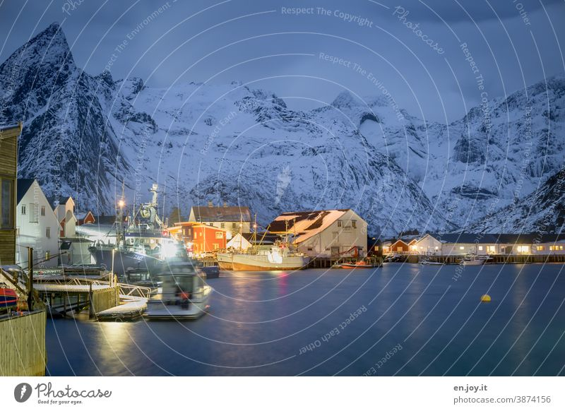Blue hour in the port of Hamnoy on the Lofoten Lofotes hamnoy Norway Scandinavia Harbour North Meadow Snow Cold Mountain Snowcapped peak blue hour Evening