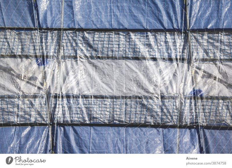 Tarpaulin lashed Construction site tarpaulin fixed sealed tight Scaffolding Shadow seal off Screening Protection Safety secure impenetrable obstructed too