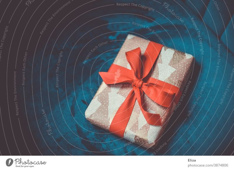 Christmas present with red ribbon on blue background Gift Christmas gift Bow Red Blue Packaged Christmassy christmas eve Donate Christmas & Advent