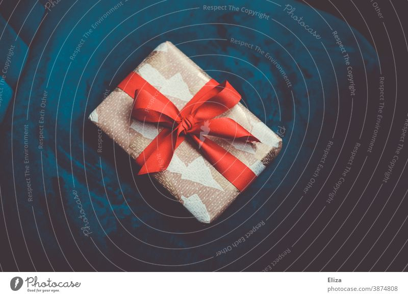 Christmas present on blue background Christmas gift Blue Red Christmassy Donate Giving of gifts Christmas & Advent Bow Gift Noble
