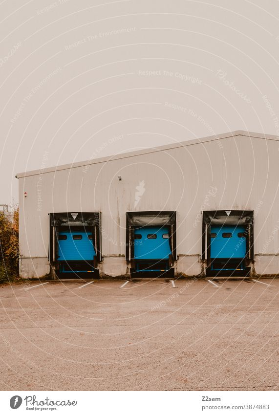 Industrial hall with truck loading ramps Industry Goal Architecture Production Parking Gray White clean lines graphically Building Garage Deserted Transport