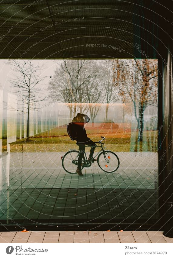 Self portrait of a photographer on a bicycle Bicycle Cycling Photographer Take a photo Mirror Slice Window Nature reflection Autumn trees warm colors Young man