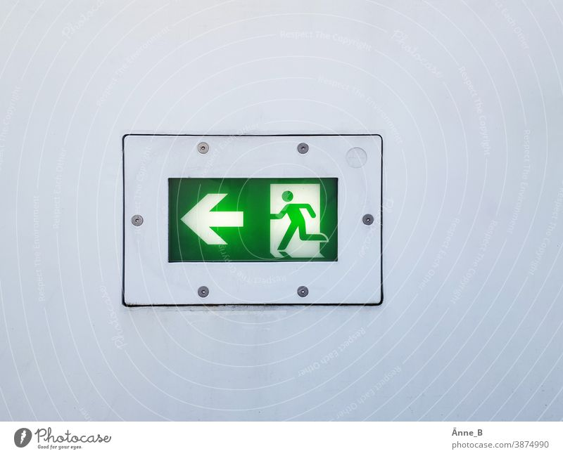 Escape route to the left Emergency exit Emergency exit to the left escape route Signal Green Safety escape route marking Rescue sign Flee Emergency lighting