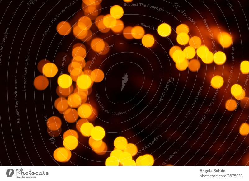 Lots of colorful blurred circles of light background glowing abstract yellow shiny bokeh design focus bright effect shine night pattern illustration festive