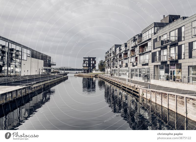 Modern houses on the waterfront House (Residential Structure) Water dwell real estate Building luxury Architecture Manmade structures Facade Window