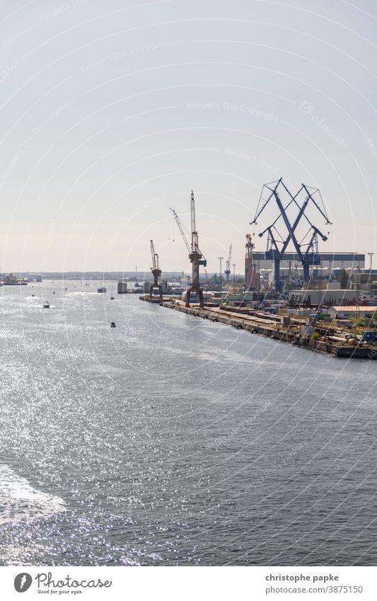 Port of Warnemünde Harbour Warnemuende dockyard Crane Industry Dockside crane Ocean Baltic Sea River Logistics Work and employment Navigation Copy Space top