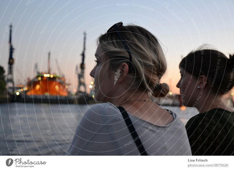 PORT - TWILIGHT HAMBURG - OBSERVATION Woman Blonde girlfriends Friendship Summer Together Exterior shot Braids Twilight Evening Dusk Beautiful weather Harbour