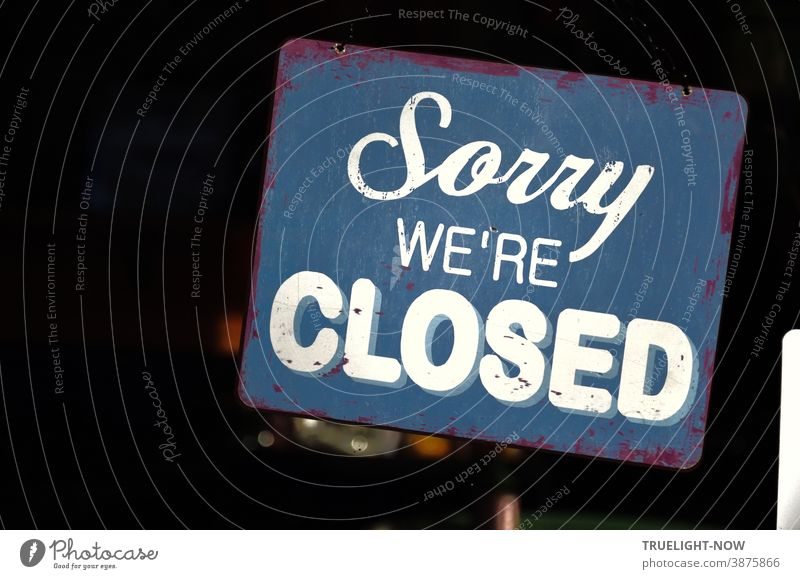 Sorry we're CLOSED Blue vintage metal sign with white lettering in the window of a restaurant has special meaning in the pandemic lockdown time of bankruptcies | Corona Thoughts