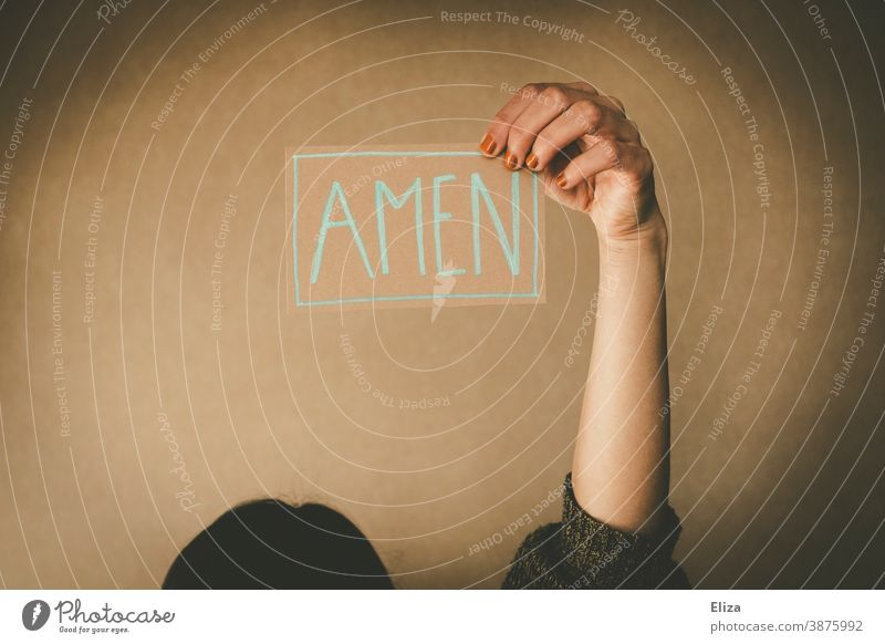 A woman holds a sign saying Amen. Concept praying, preaching and church. Church Belief Prayer Sermon Holy religion Church service amen say amen