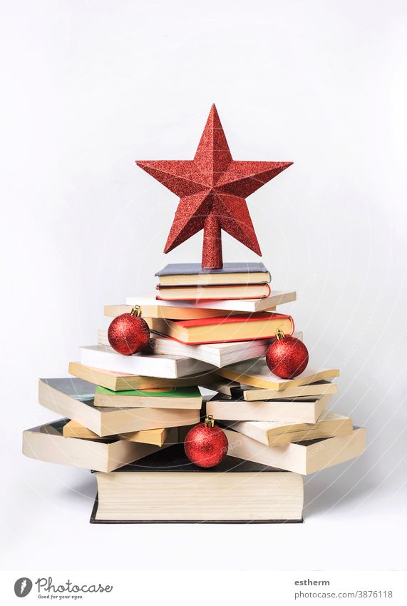 Christmas concept background. Books in the form of a christmas tree books christmas background read textbook know learn study bookstore reading christmas eve