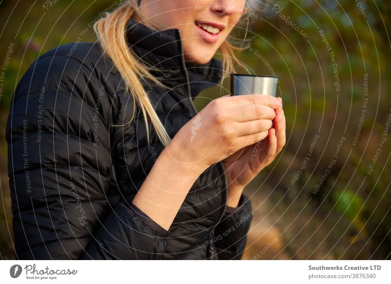 Close Up Of Woman Taking A Break From Countryside Hike And Drinking Coffee From Flask coffee hike walking woman young women hiking trek camping taking a break